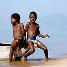 Kids and canoe by DUNCAN DAVIE