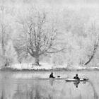 Canoes on river in winter von Manfred Belau