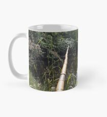 Fishing in a stream Mug