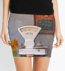 still life with a white scale and flowers Mini Skirt