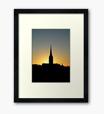 God's Grandeur: Salisbury Cathedral in silhouette at sunset, southern England Framed Print