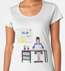 Girl sitting at the table and working on laptop. Women's Premium T-Shirt