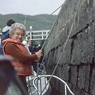 Marj guiding our boat up the lock Wall, Cullochy Lock on Caledonian Canal Scotland 19840912 0014  by Fred Mitchell