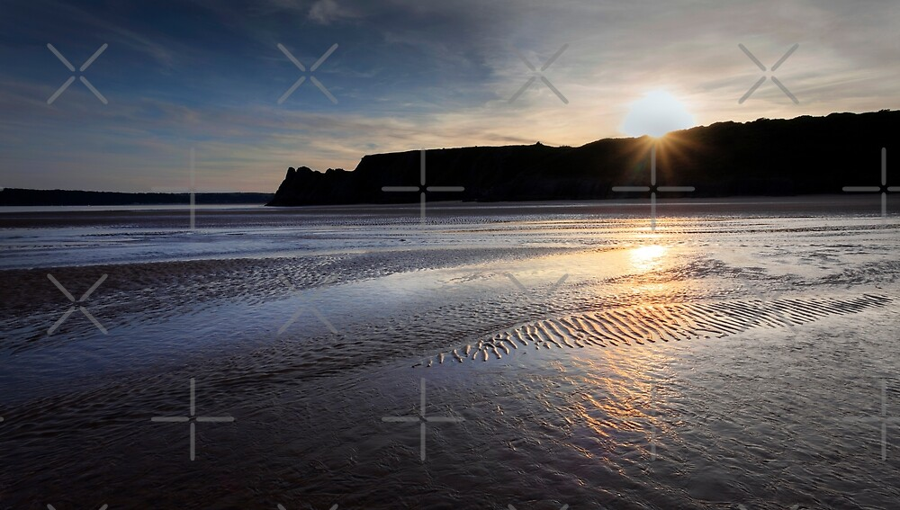 Sunset and wet sand by Leighton Collins