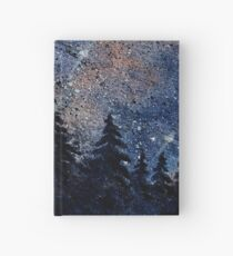 Pine trees and galaxies watercolor painting by Bazil Zerinsky Hardcover Journal