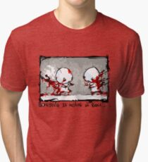 Something Is Holding Us Back! Tri-blend T-Shirt