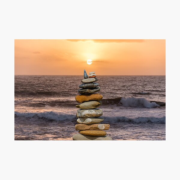 Stone Stacking on an Italian Beach at Sunset Photographic Print