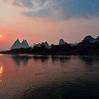 Li River Cruise & The Harst Mountain Range. Yangshuo, China. by Ralph de Zilva