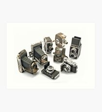 an assortment of old style film cameras        Art Print