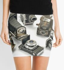 an assortment of old style film cameras        Mini Skirt