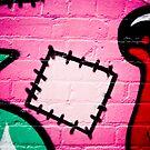 Textured graffiti detail on the brick wall by yurix