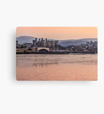 Conwy Castle and harbour at dusk Canvas Print