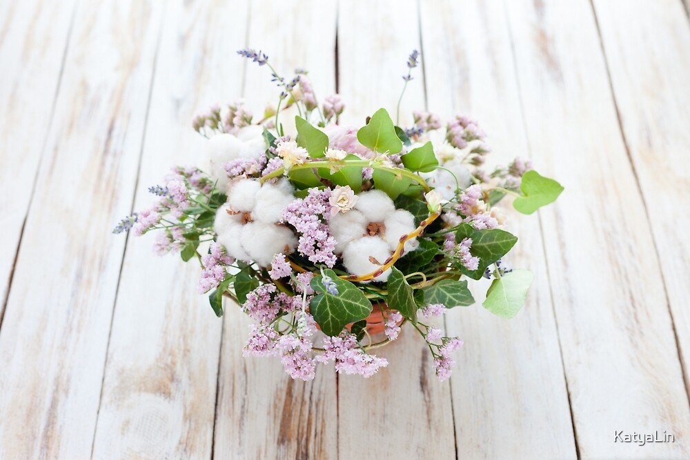 Bouquet of flowers on a old wooden background by KatyaLin