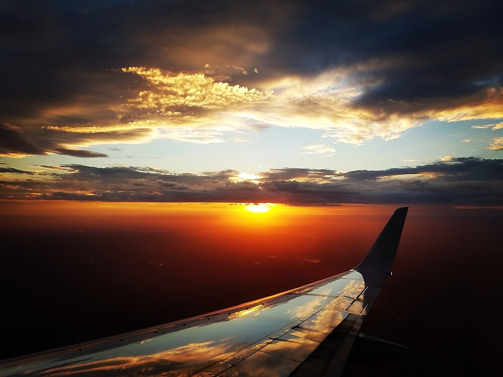Sunset from plane by nadunr