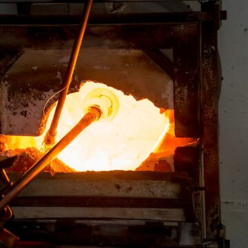 Glassmaker's workshop the glass is in the oven to melt before forming  by PhotoStock-Isra