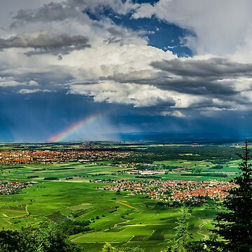 Beautiful rainbow with rainy clouds, colorful summer view, Alsace, France by sorokopud