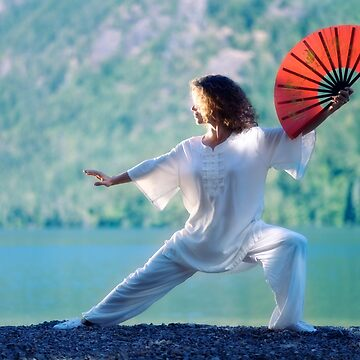 Woman practicing Tai Chi with a fan in sunrise in the nature art photo print by AwenArtPrints