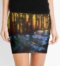 Winter sunset in a snowy forest Mini Skirt