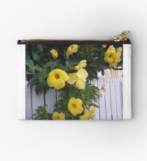 yellow flowers on the gatedoor Studio Pouch