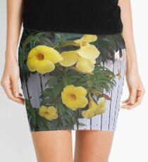 yellow flowers on the gatedoor Mini Skirt