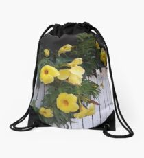 yellow flowers on the gatedoor Drawstring Bag