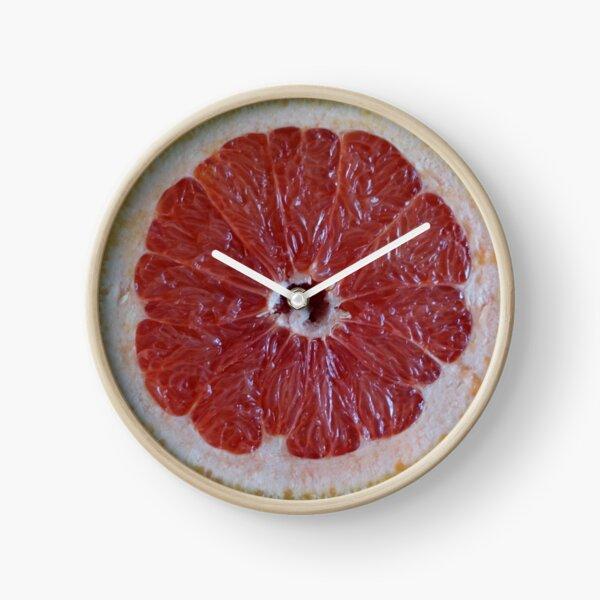 Cut grapefruit. Clock