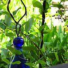 Colors of Amusement--Blue Glass by sadeyedartist
