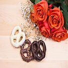 Chocolate Pretzels With Lovely Orange Roses by daphsam