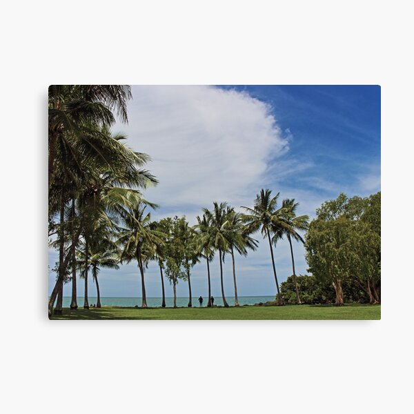 Tropical waterfront park with palm trees Canvas Print