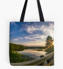 sunset looking down river with bridge  Tote Bag