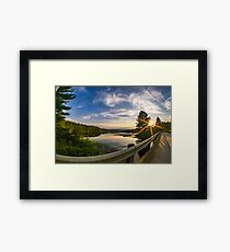 sunset looking down river with bridge  Framed Print