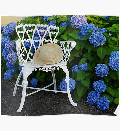 Straw hat, blue Hydrangeas and a Patio chair Poster