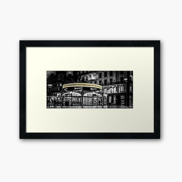 A long Exposure on a French Carousel Framed Art Print