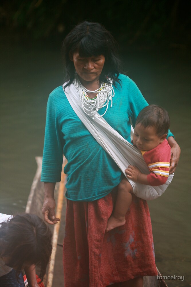 Woadani woman and grandson in dugout canoe by tomcelroy