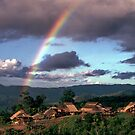 Village and rainbow by John Spies