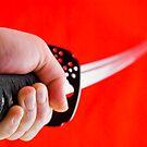 Hand holding Japanese sword katana by yurix