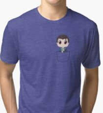 Chibi Connor in a pocket Tri-blend T-Shirt