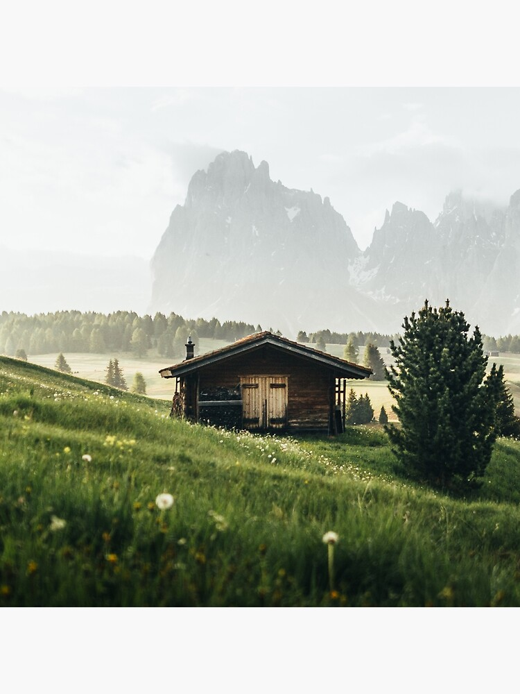 Cabin in front of mountains on Alpe di Siusi  by marinaweishaupt