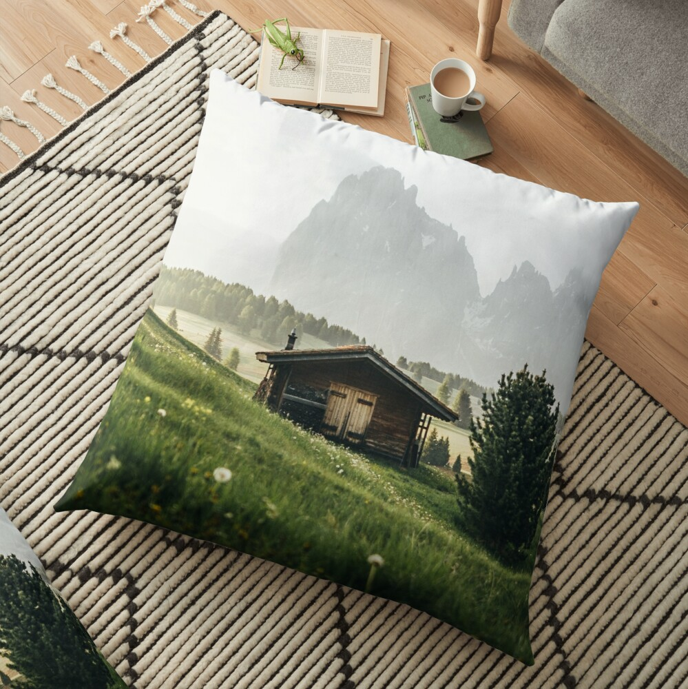 Cabin in front of mountains on Alpe di Siusi  Floor Pillow