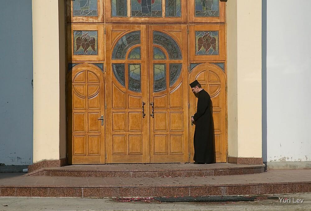 Priest Locking Church Doors, Chortkiw Ukraine by Yuri Lev