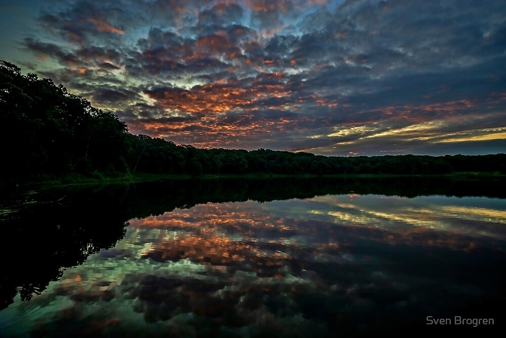 Colorful sky reflected in lake water  by Sven Brogren