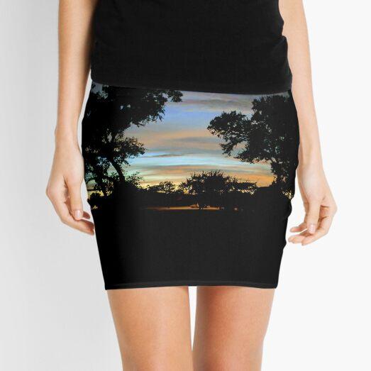 Twilight sunset with old trees Mini Skirt