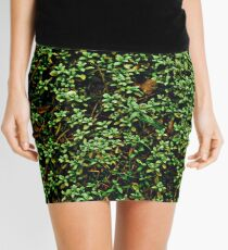 Texture vines with brick wall red bricks climbing green jungle vines and wild plants vintage eroded grunge style urban pattern Mini Skirt