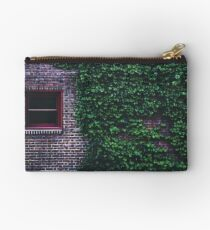 Texture Brick wall red bricks with climbing green vines wild plants and rustic red wooden window vintage grunge style urban pattern Studio Pouch