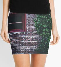 Texture Brick wall red bricks with climbing green vines wild plants and rustic red wooden window vintage grunge style urban pattern Mini Skirt