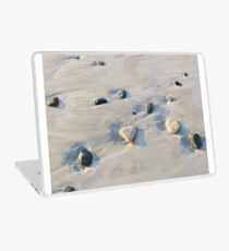 Pebbles on the sand Laptop Skin