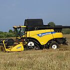 Combine out in the field by Barrie Woodward