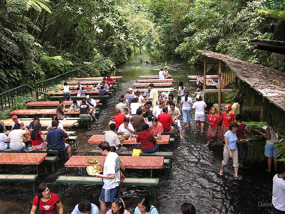 Restaurant in the river below a waterfall, Villa Escudero, San Pablo City, Philippines by Dave P