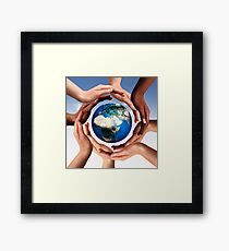 Multiracial hands making a circle together around the world globe art photo print Framed Print
