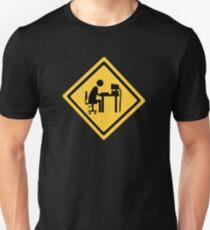 Man sitting at an office desk. Unisex T-Shirt